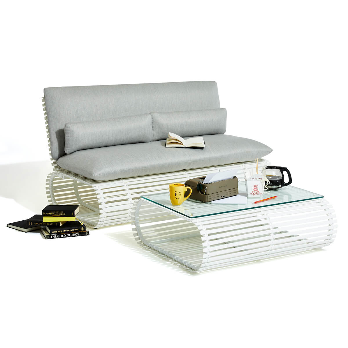 Stori Modern Novel outdoor love seat and coffee table in white with gray cushions.