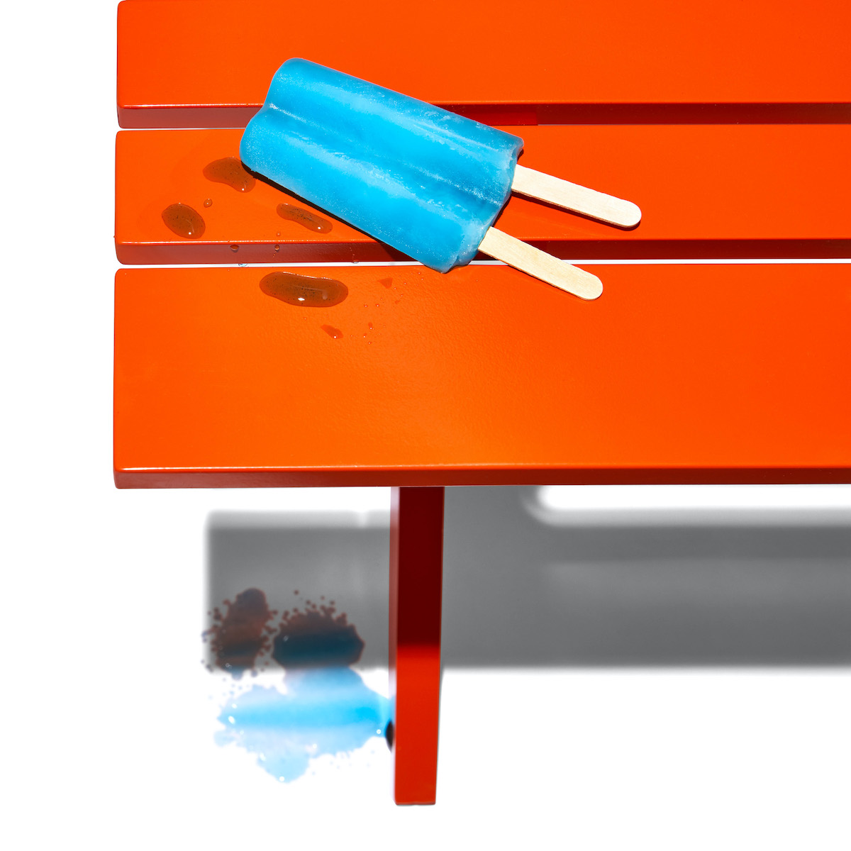Stori Modern Graphic outdoor coffee table in orange with blue popsicle