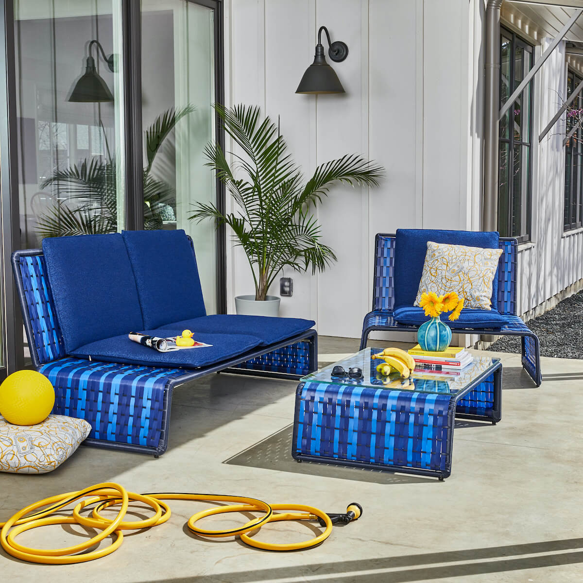 stori modern tabloid woven outdoor seating in blue