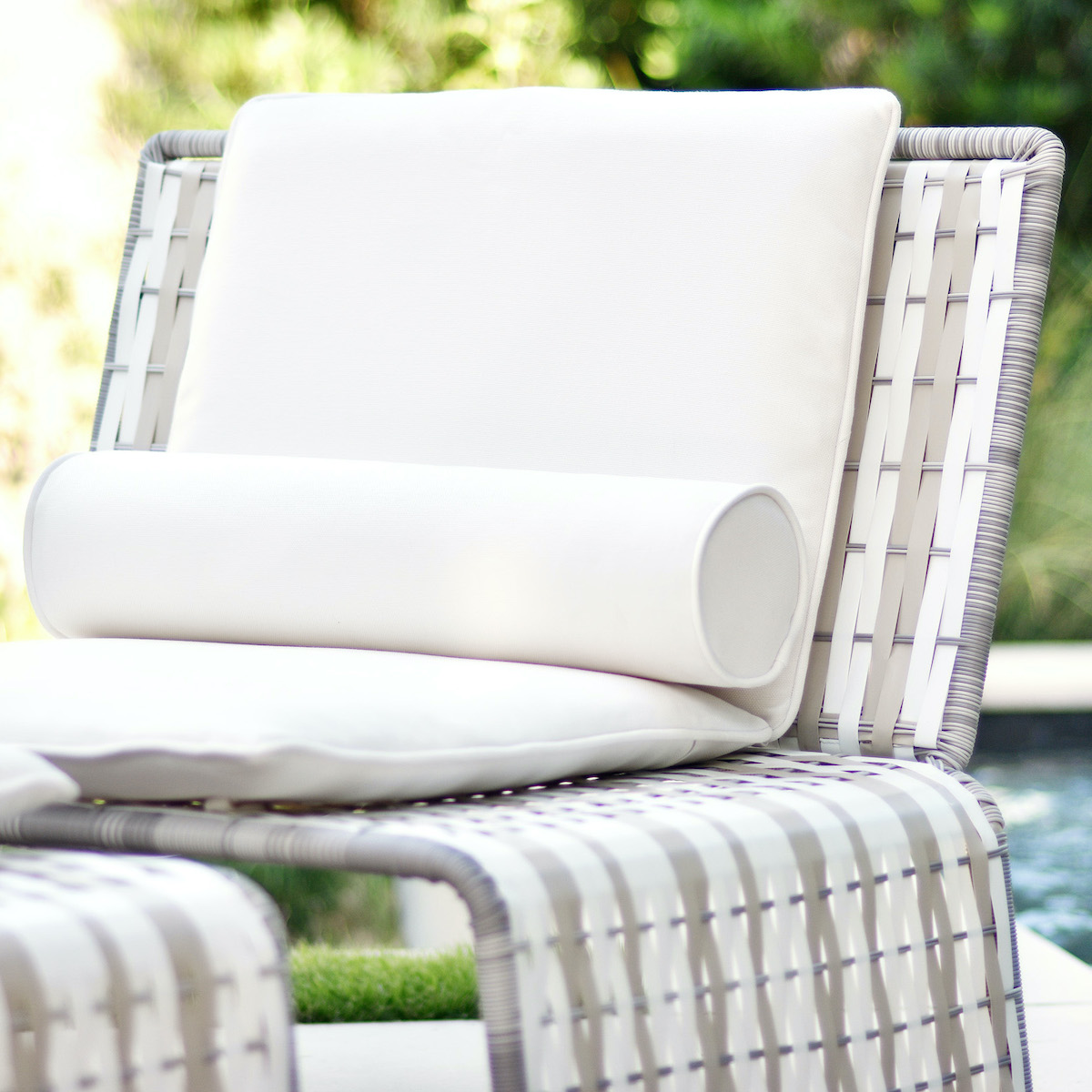 stori modern tabloid lounge chair and ottoman in white by the pool