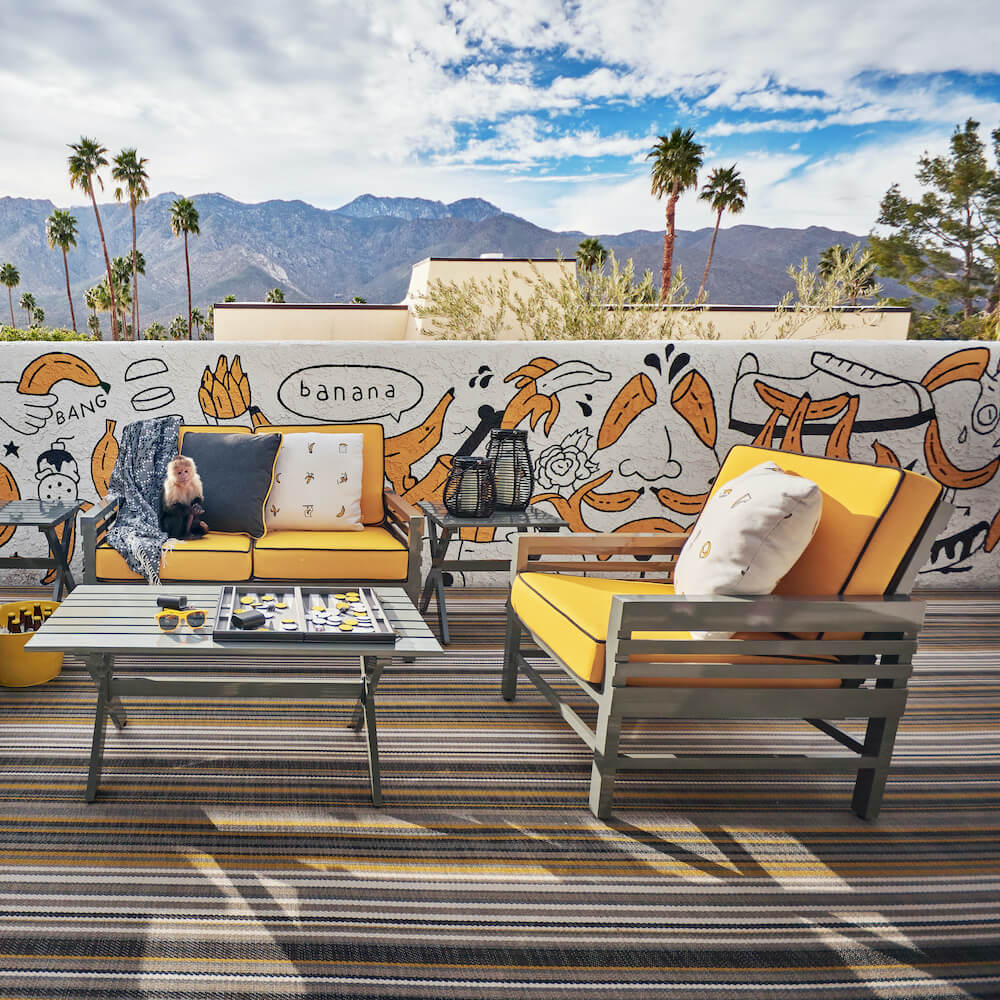 Graphic lounge chair and love seat in Palm Springs with Monkey