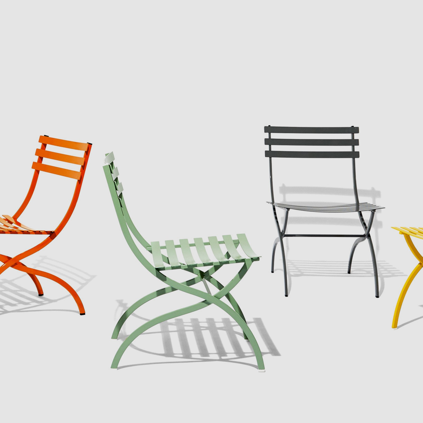 Stori Modern Journal bistro style chairs shown in mint, orange, black and  yellow.