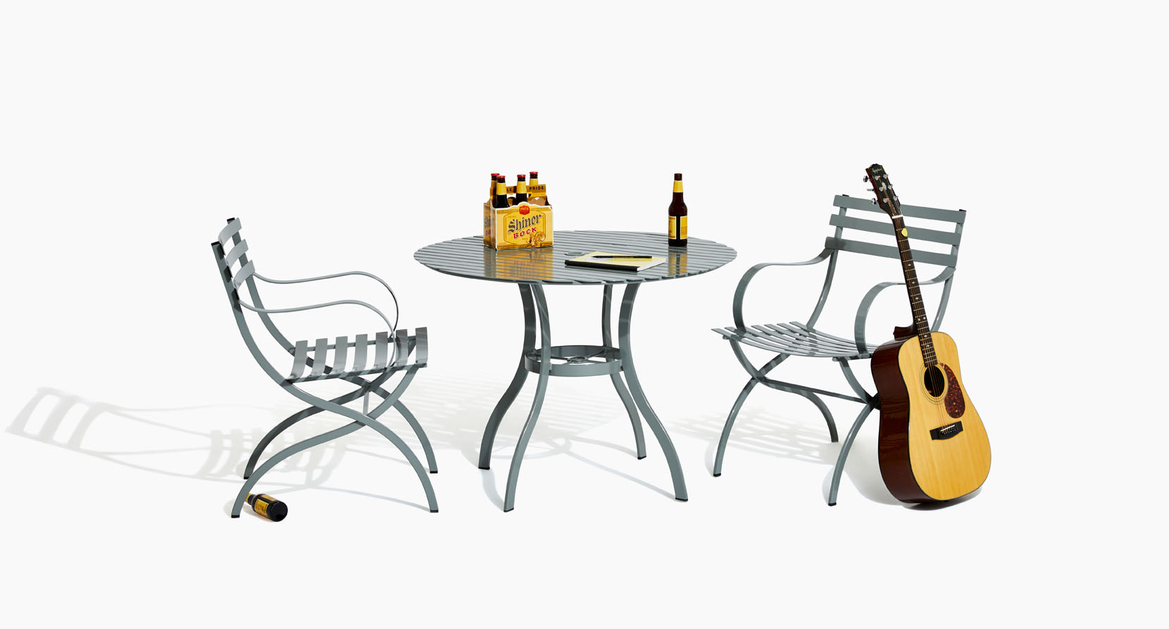 The Journal Collection Outdoor Dining Table and Side Chairs