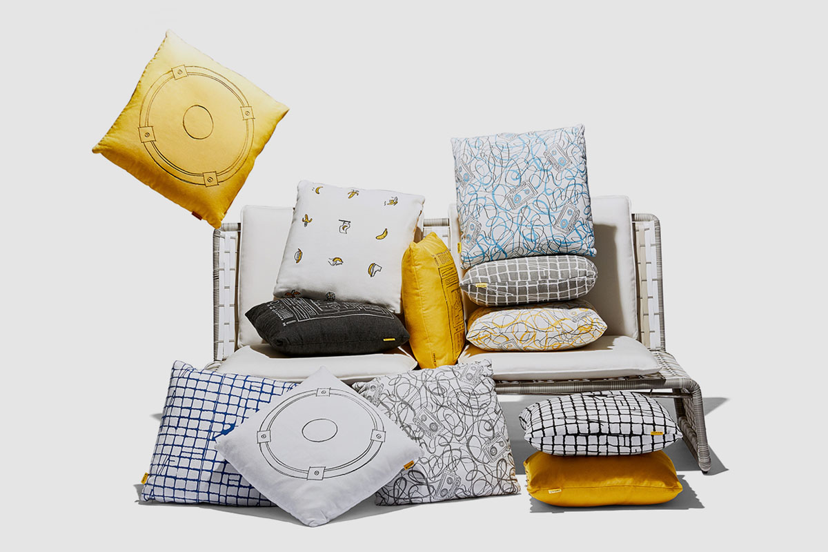 stori modern outdoor pillows on tabloid love seat